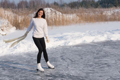Figure skating woman at the frozen lake Royalty Free Stock Photography