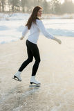 Figure skating woman at the frozen lake royalty free stock images