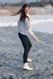Figure skating woman at the frozen lake stock photo