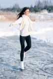 Figure skating woman at the frozen lake royalty free stock photo