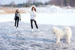 Figure skating women at the frozen lake Royalty Free Stock Image