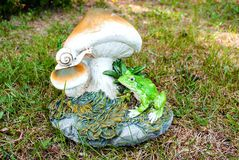 Figure of a snail and frog Stock Images