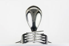 Figure of spoon and two forks. Spoon and two forks formed into conceptual figure Royalty Free Stock Photography
