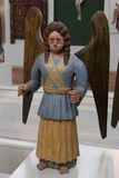 The figure of the standing angel from the collection of the Perm. PERM, RUSSIA-MARCH 26, 2017: Figure of an angel from the collection of wooden sculpture of Perm Stock Photos