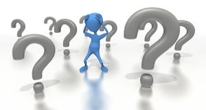 Figure stands among a bunch of question marks Stock Photography