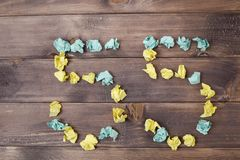 Figure 55 on a table. Crumpled pieces of paper in the form of balls, forms figure 55 on a dark wooden Royalty Free Stock Photos