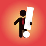 Figure with tie holding white exclamation mark Royalty Free Stock Images