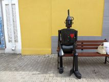The figure of the tin man on the bench Stock Photo