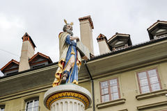 The figure on top of the Moses fountain. Bern, Switzerland - April 17, 2017: The figure who stands on top of the ornate pillar of the Moses fountain Mosesbrunnen Royalty Free Stock Photos