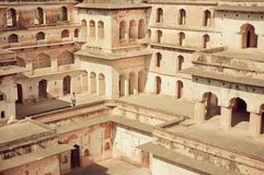 Figure of a tourist in maze of levels in historical structure of fortress Jahangir Mahal. Stock Photography