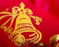Figure una Bell en la tela roja Fotografía de archivo libre de regalías