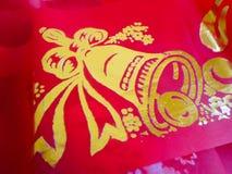 Figure una Bell en la tela roja Imagen de archivo libre de regalías
