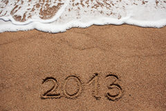 Figure in 2013 was written on the sea sand Royalty Free Stock Images
