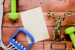 Figure weightlifter, dumbbells and expander Stock Image