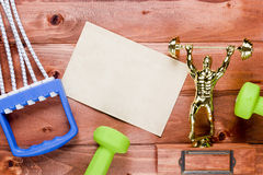 Figure weightlifter, dumbbells and expander Royalty Free Stock Image