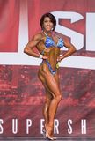 Figure Winner at 2018 Toronto Pro Supershow. Alexis Sullivan, from Lyndhurst, New Jersey, poses at the Pro Fitness contest of the 2018 Toronto Pro Supershow at royalty free stock images