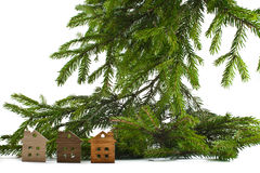 Figure of a wooden house on a background of green fir branches Royalty Free Stock Images