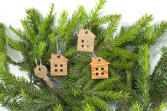 Figure of a wooden house on a background of green fir branches Royalty Free Stock Photography