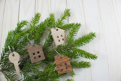 Figure of a wooden house on a background of green fir branches Stock Photography