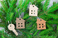 Figure of a wooden house on a background of green fir branches Stock Photo