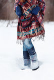 The figure of a young woman in bright ethnic scarf Royalty Free Stock Photography