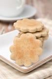 Figured cookies and a cup of tea closeup Stock Photos