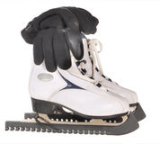 The figured fads. The figured skates, gloves stand on a table Stock Photography
