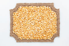 Figured frame of burlap with  peas Royalty Free Stock Photos