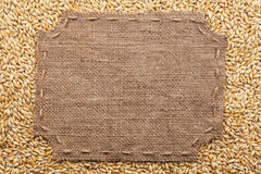 Figured frame with burlap and stitches with  place for your text Stock Image