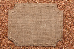 Figured frame with burlap and stitches with  place for your text Stock Photos