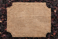 Figured frame with burlap and stitches with  place for your text Stock Images
