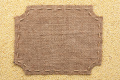 Figured frame with burlap and stitches with  place for your text Royalty Free Stock Images
