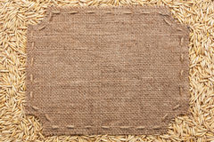 Figured frame with burlap and stitches with  place for your text Royalty Free Stock Photography