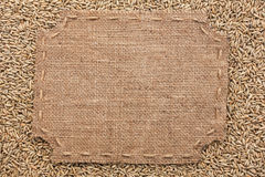 Figured frame with burlap and stitches with  place for your text Royalty Free Stock Photo