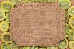 Figured frame made of burlap on dried kiwi Stock Photo