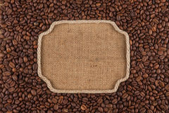 Figured frame made of rope with coffee beans on sackcloth Stock Images