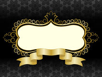 Figured golden frame with ribbon. On a black background with a gothic pattern Stock Photo