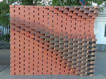 Figured masonry walls, dry, red brick without cement - an abstract picture. stock image