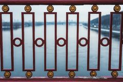 Figured metal fence against the background of a river. Horizontal frame stock image