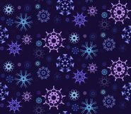 Figured Snowflakes Pattern. Vector seamless pattern with different figured snowflakes Stock Photo
