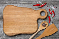 Figured Wooden Cutting Board, Spoon, Spatula And Spices, Top View Stock Photography