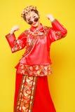 """Figurerar människan"""" för — för †för kinesisk stil för mode fotografi Arkivbild"""