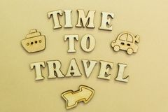 Figures of the airplane, car and ship, the inscription `time to travel. stock photography