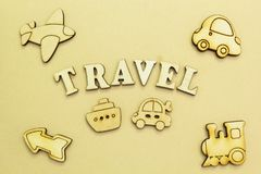 Figures of an airplane, a car, a ship, a train, an inscription `travel.. royalty free stock photo