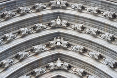 Figures on the arch of the portal in Barcelona cathedral Stock Images
