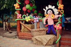 Figures from balloons. It is festively decorated with figures from color balloons of the ranch Stock Photography