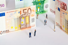 Figures and bank notes Royalty Free Stock Photo