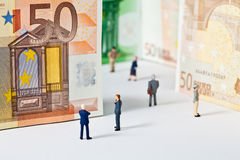 Figures and bank notes Royalty Free Stock Photography