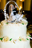 Figures of bride and groom. Wedding cake with figures of bride and groom on the top Royalty Free Stock Images