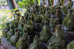 Figures of Buddhist monks made of stone royalty free stock images